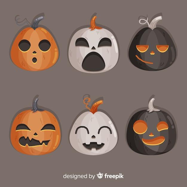 Platte ontwerp van halloween griezelige pompoenen Gratis Vector
