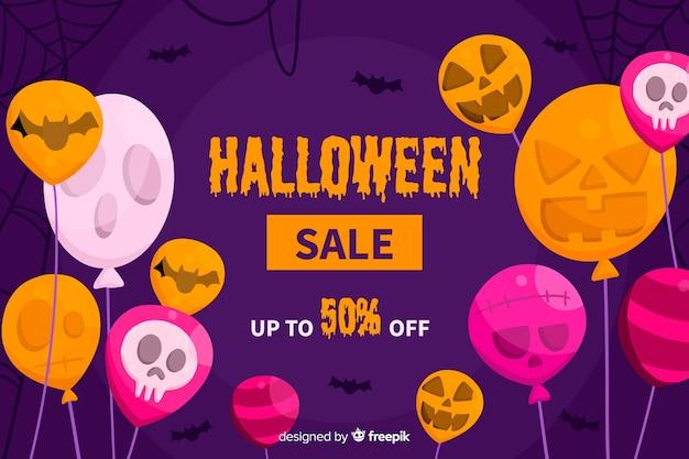 Platte ontwerp van halloween verkoop achtergrond met ballonnen Gratis Vector
