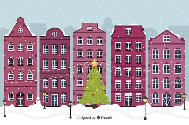 Platte ontwerp van kerststad Gratis Vector
