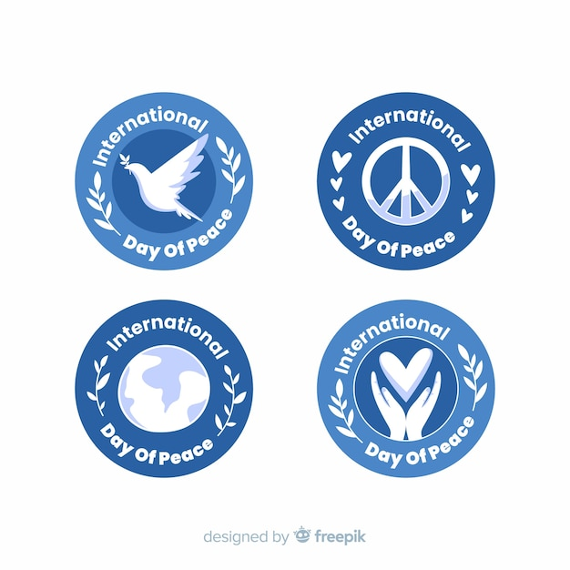 Platte ontwerp vredesdag badge-collectie Gratis Vector