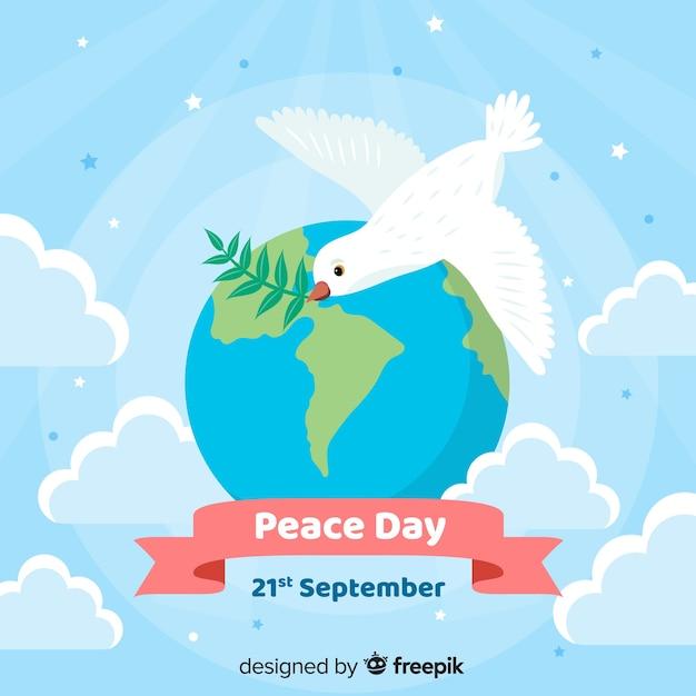 Platte ontwerp vredesdag duif vliegt over de wereld Gratis Vector