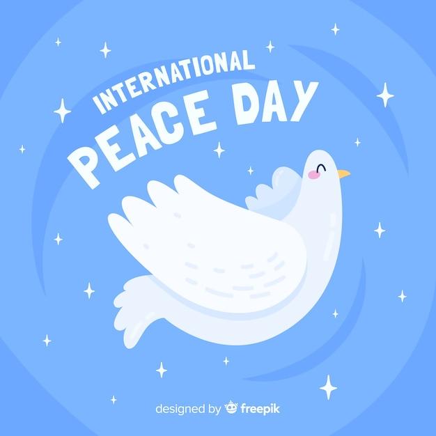 Platte ontwerp vredesdag met een duif Gratis Vector