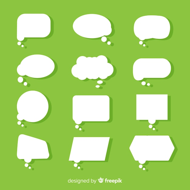 Platte papier stijl tekstballon op groene achtergrond Gratis Vector