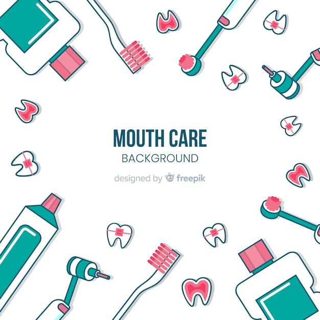 Platte tandarts achtergrond Gratis Vector