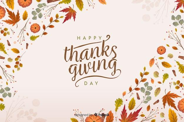 Platte thanksgiving achtergrond met gedroogde bladeren Gratis Vector