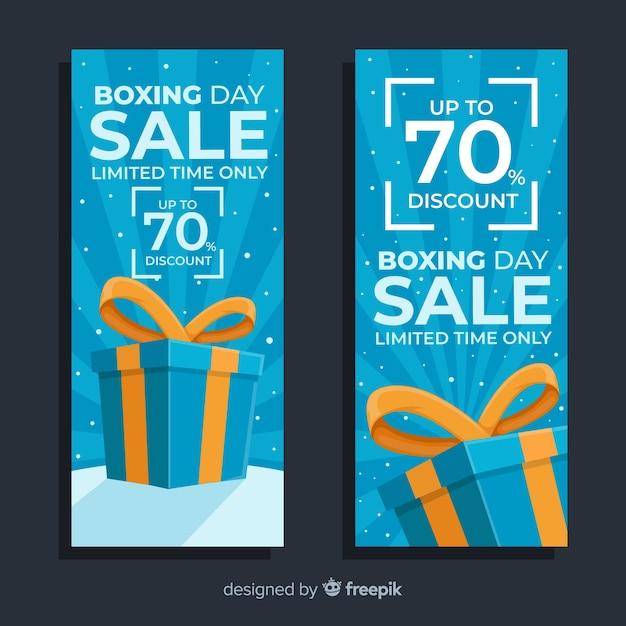 Platte tweede kerstdag verkoop banners in blauwe tinten Gratis Vector