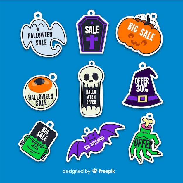 Platte verkoop badge met halloween wezens Gratis Vector