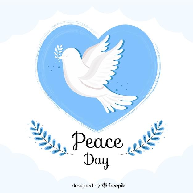 Platte vredesdag in een hartbel Gratis Vector