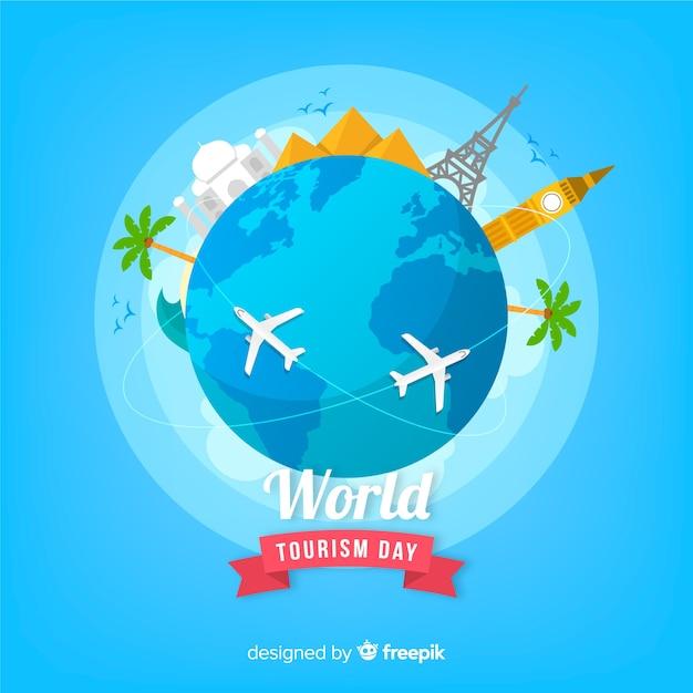 Platte wereld toerisme dag achtergrond met bezienswaardigheden Gratis Vector