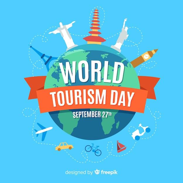 Platte wereld toeristische dag met toeristische attracties Gratis Vector
