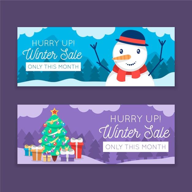 Platte winter verkoop banners met close-up sneeuwpop en kerstboom Gratis Vector