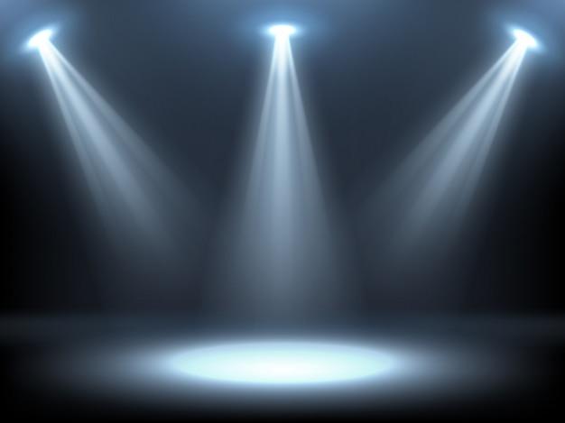 Podium verlicht door schijnwerpers Gratis Vector