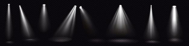 Podiumlichten, witte schijnwerpers, gloeiende designelementen voor studio- of theaterscène Gratis Vector