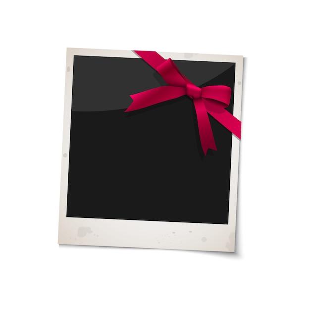 Polaroid fotolijst met strik rood lint Premium Vector