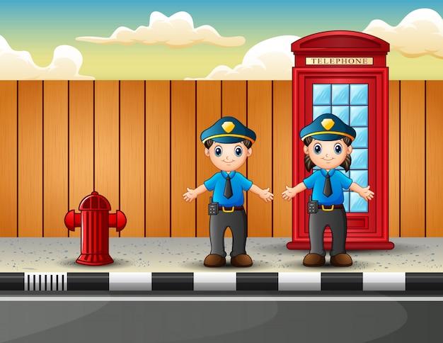 Politieman mannelijk en vrouwelijk op de stadsstraat Premium Vector