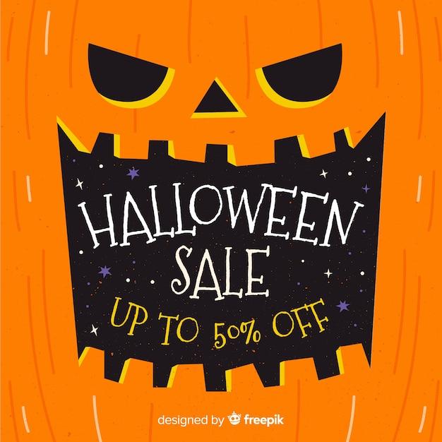 Pompoen hand getrokken halloween verkoop banner Gratis Vector