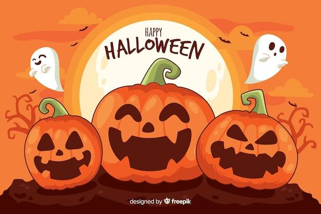 Pompoenen en spoken halloween-achtergrond Gratis Vector