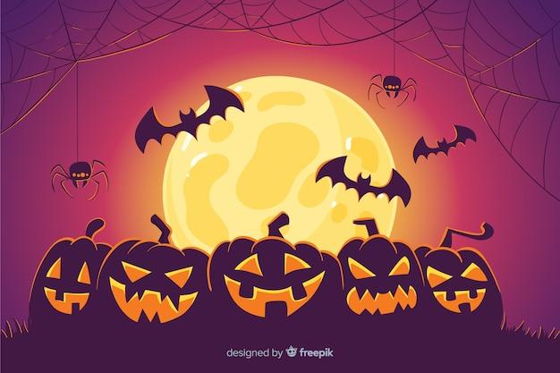 Pompoenen en vleermuizen halloween achtergrond Gratis Vector