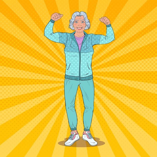 Popart glimlachend senior volwassen vrouw spieren tonen. gezonde levensstijl. gelukkig grootmoeder. Premium Vector
