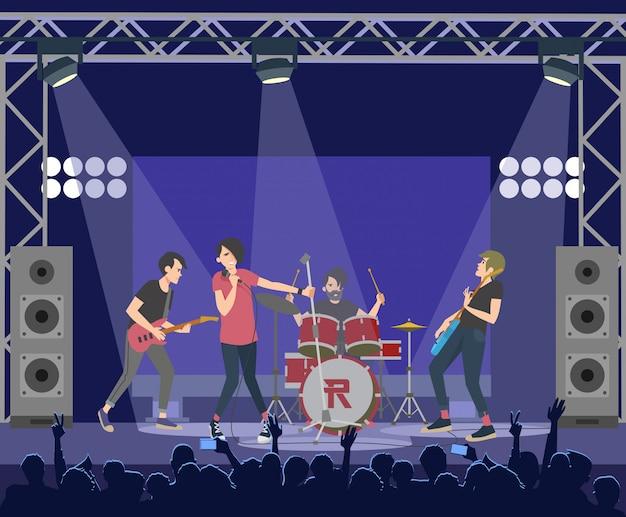 Populaire rocksterren die op het podium optreden Gratis Vector