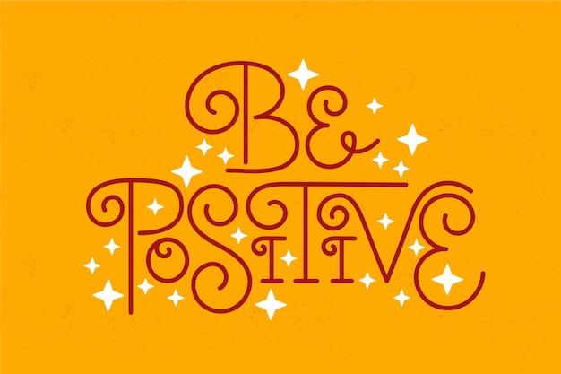Positieve geest belettering concept Gratis Vector