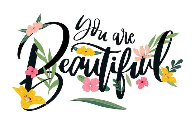 Positieve letters met bloemen Gratis Vector