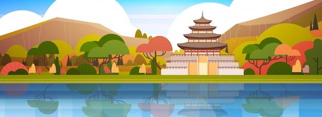 Prachtige zuid-koreaanse landschap traditionele paleis of tempel over bergen koreaanse beroemde bezienswaardigheid view Premium Vector