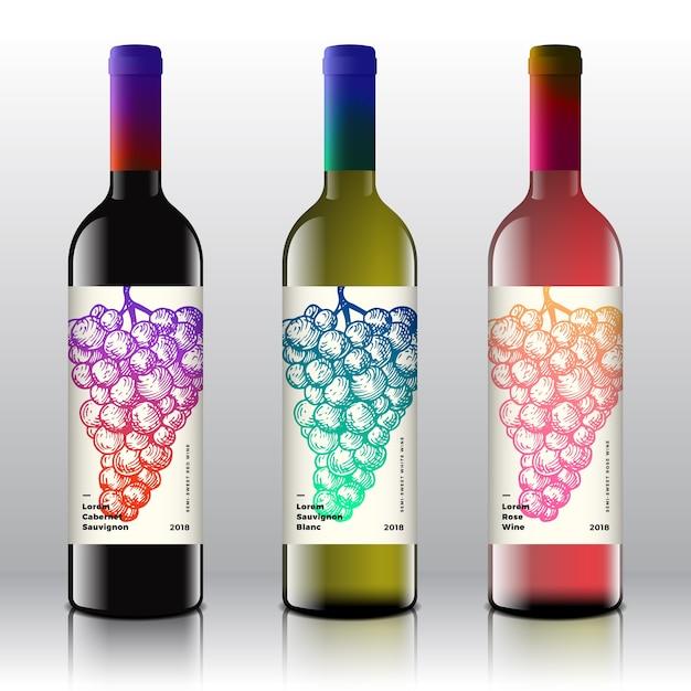 Premium kwaliteit rode, witte en roze wijnetiketten op de realistische flessen. Gratis Vector