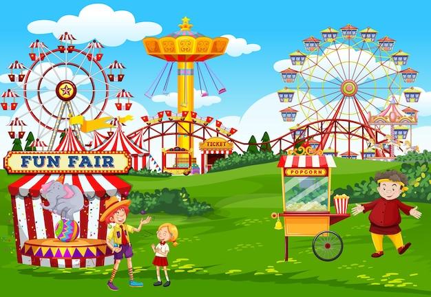 Pretpark met thema-scène van circus en popcornkar Gratis Vector