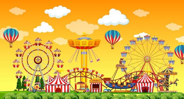 Pretparkscène overdag met ballonnen in de lucht Premium Vector
