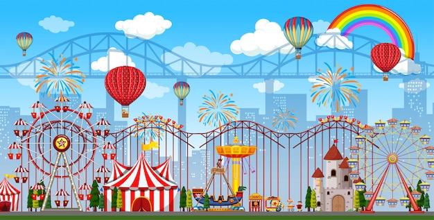 Pretparkscène overdag met regenboog en ballonnen in de lucht Premium Vector