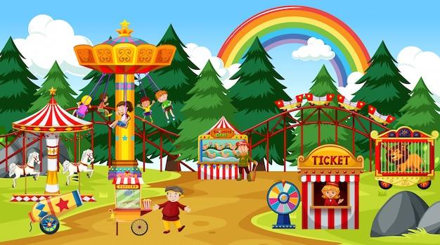 Pretparkscène overdag met regenboog in de hemel Gratis Vector