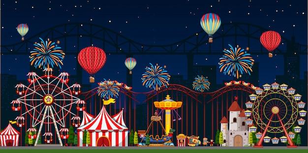 Pretparkscène 's nachts met ballonnen en vuurwerk Premium Vector