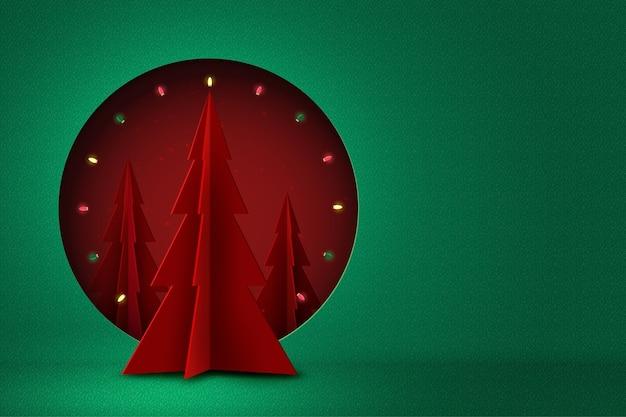 Prettige kerstdagen en gelukkig nieuwjaar concept rode cirkel versierd met kerstboom en licht op groene achtergrond papier art Premium Vector