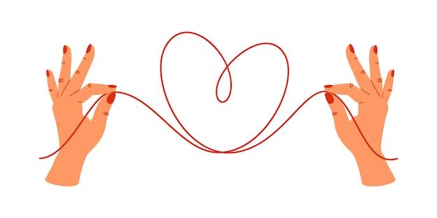 Psychologie concept. menselijke handen met de uiteinden van rode draden in de vorm van een hart. Premium Vector