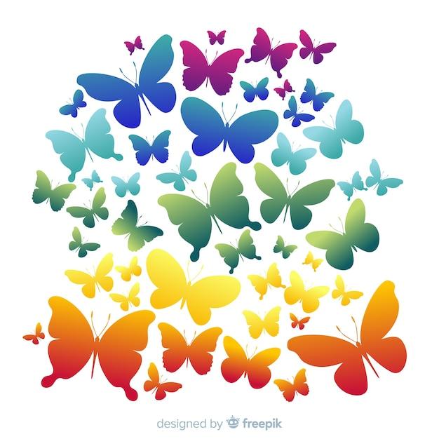 Rainbow zwerm vlinder silhouetten achtergrond Gratis Vector