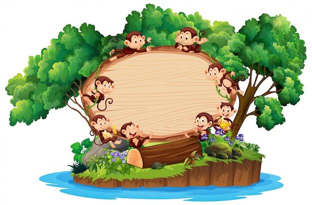 Randsjabloon met veel apen op eiland Gratis Vector