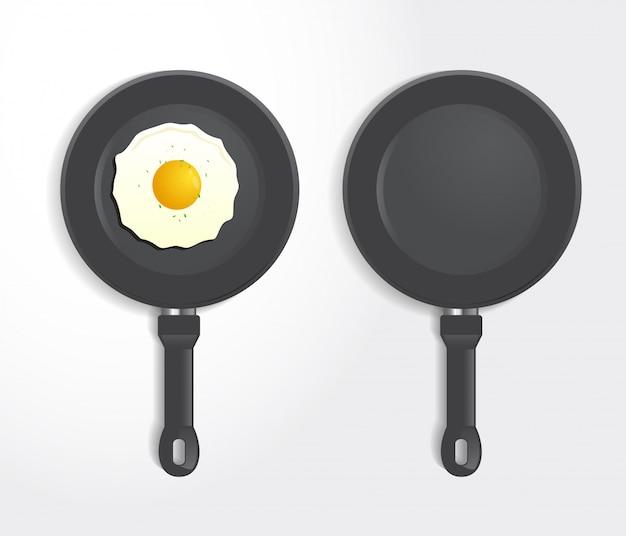 Realistisch fried egg op pan top view Premium Vector