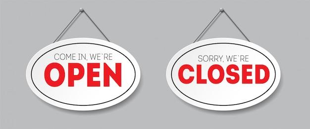Realistisch ovaal teken met geïsoleerde schaduw. sorry we zijn gesloten. kom binnen, we zijn open. bord met een touw. Premium Vector