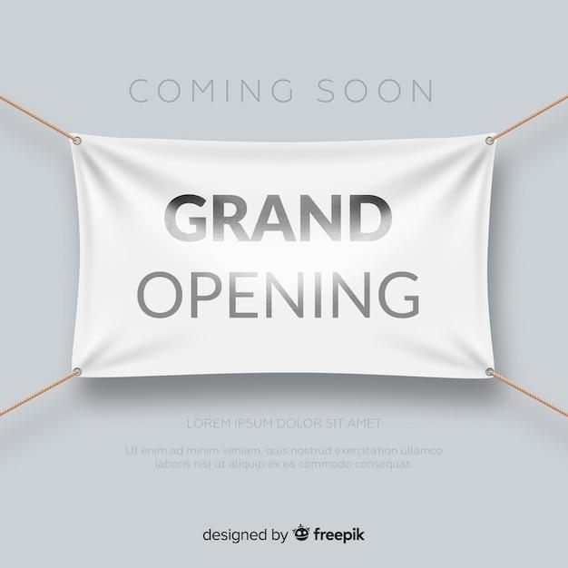 Realistische grootse opening poster met textiel banner Gratis Vector