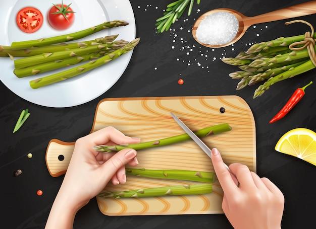 Realistische handen snijden asperges Gratis Vector