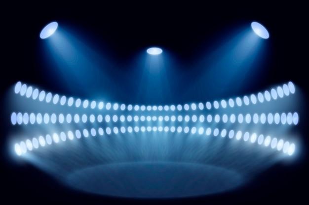 Realistische heldere stadionlichten Gratis Vector