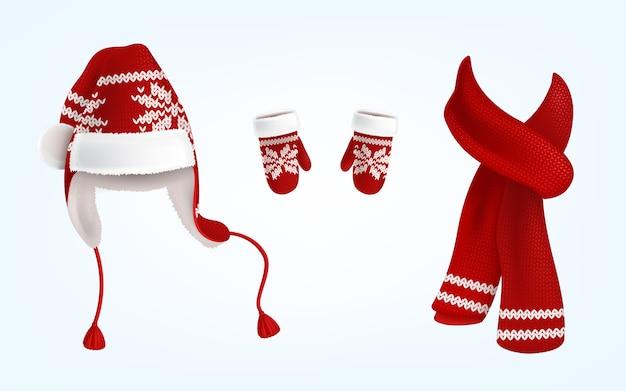 Realistische illustratie van gebreide kerstmuts met oorflappen, rode wanten en sjaal Gratis Vector