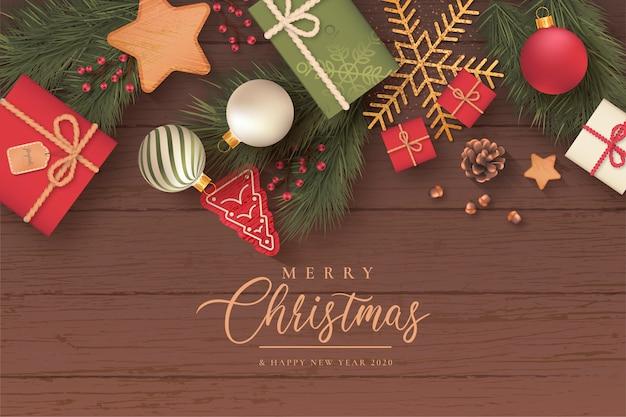 Realistische kerst achtergrond met schattige ornamenten Gratis Vector