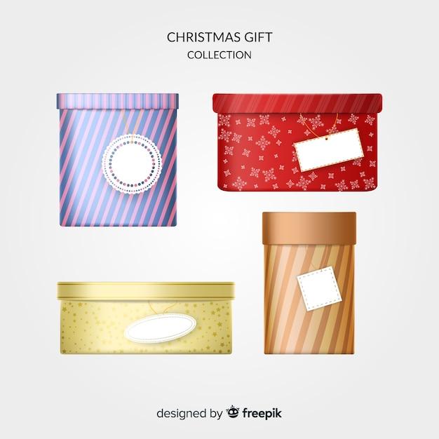 Realistische kerst geschenkverpakking Gratis Vector