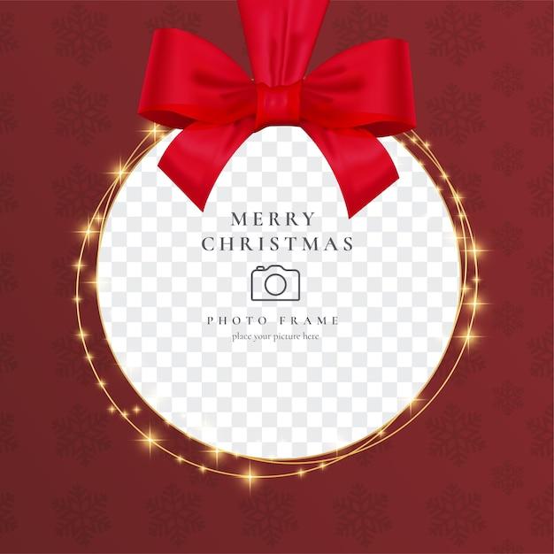 Realistische kerstfotokader met rood lint Gratis Vector