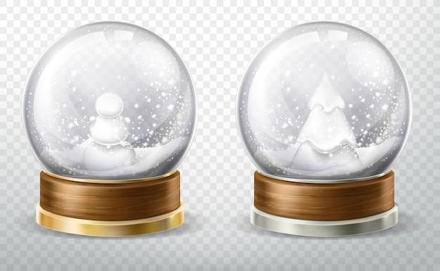 Realistische kristallen bol ingesteld met gevallen sneeuw Gratis Vector