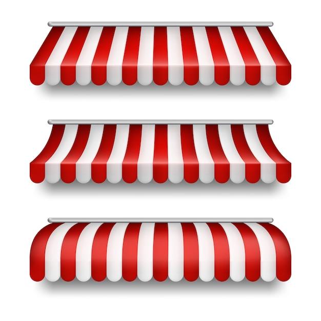Realistische set van gestreepte luifels geïsoleerd op de achtergrond. clipart met rode en witte tenten Gratis Vector