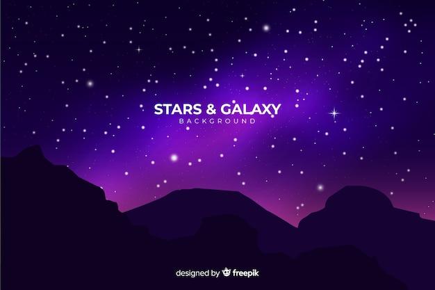 Realistische sterrennachtachtergrond Gratis Vector