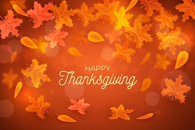 Realistische thanksgiving achtergrond met bladeren Gratis Vector